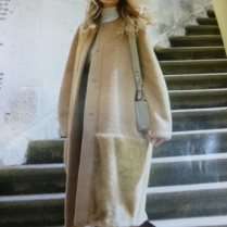 Magazine image of a version of the coat